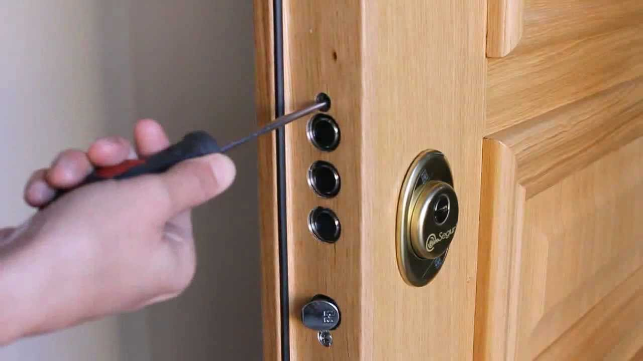 poner cerradura en puerta blindada